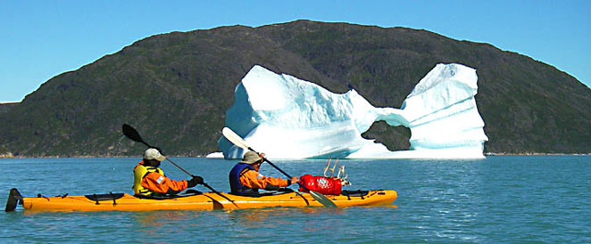 Kayak among icebergs after the ice cap hiking trip